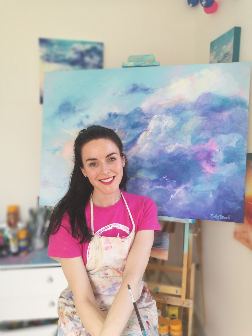 Artist in front of easel